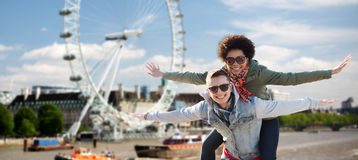 Happy teenage couple having fun over london Royalty Free Stock Images