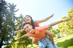 Happy teenage couple having fun at summer park Royalty Free Stock Photo