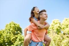 Happy teenage couple having fun at summer park Royalty Free Stock Photography