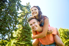Happy teenage couple having fun at summer park. Holidays, vacation, love and people concept - happy smiling teenage couple having fun at summer park Stock Photography