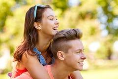 Happy teenage couple having fun at summer park Stock Photos