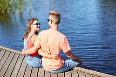 Happy teenage couple hugging on river berth Royalty Free Stock Photo
