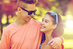 Happy teenage couple looking at each other in park Royalty Free Stock Photos