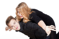 Happy teenage couple piggybacking Royalty Free Stock Photos
