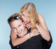 Happy teenage couple piggybacking Stock Image