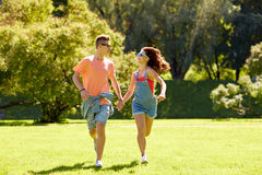 Happy teenage couple running at summer park Stock Photo