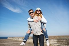Happy teenage couple in shades having fun outdoors Stock Photo