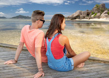 Happy teenage couple sitting on river berth Royalty Free Stock Photography
