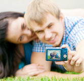 Happy teenage couple taking picture Stock Photos