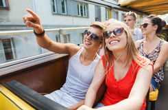 Happy teenage couple traveling by tour bus Royalty Free Stock Image