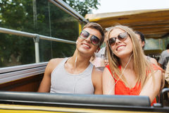 Happy teenage couple traveling by tour bus Royalty Free Stock Photo
