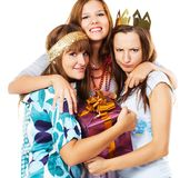 Happy teenage friends with a gift box Royalty Free Stock Photo