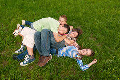 Happy teenage friends having fun in the grass Royalty Free Stock Image