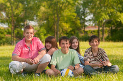 Happy teenage friends having fun in the park Stock Photos
