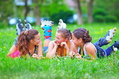 Happy teenage friends having fun in spring park Stock Images