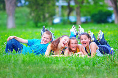 Happy teenage friends having fun in spring park Royalty Free Stock Image