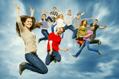 Happy teenage friends jumping in the sky Royalty Free Stock Image