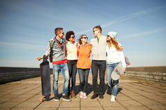 Happy teenage friends with longboards on street Royalty Free Stock Photo