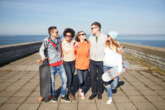 Happy teenage friends with longboards on street Royalty Free Stock Image