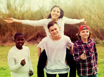 Happy teenage friends in park Stock Photo