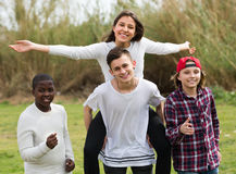 Happy teenage friends in park Royalty Free Stock Photo