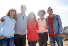 Happy teenage friends in shades hugging on street Royalty Free Stock Photo