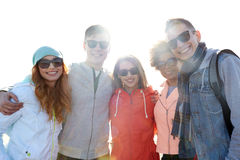 Happy teenage friends in shades hugging on street Royalty Free Stock Photography
