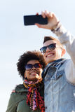 Happy teenage friends in shades taking selfie Stock Photography