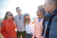 Happy teenage friends in shades talking on street Stock Image