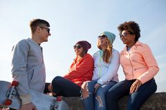 Happy teenage friends with skateboard on street Royalty Free Stock Image
