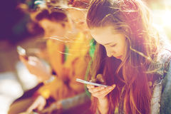 Happy teenage friends with smartphones outdoors Royalty Free Stock Photography