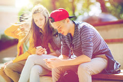Happy teenage friends with smartphones outdoors Royalty Free Stock Image