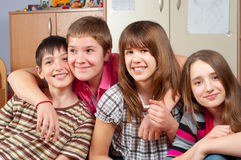 Happy teenage friends spending time together Royalty Free Stock Photo