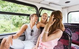 Happy teenage friends traveling by bus Royalty Free Stock Photo