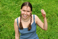 Happy teenage girl. On grass Royalty Free Stock Photography