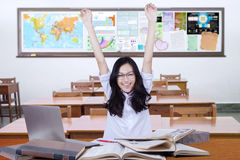 Happy teenage girl back to school and raise hands Royalty Free Stock Photos