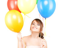 Happy teenage girl with balloons Royalty Free Stock Image