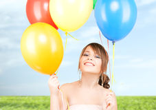 Happy teenage girl with balloons Royalty Free Stock Photos