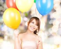 Happy teenage girl with balloons Stock Photo