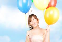 Happy teenage girl with balloons Royalty Free Stock Photo