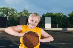 Happy teenage girl with basketball Stock Image