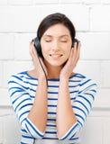 Happy teenage girl in big headphones Royalty Free Stock Image