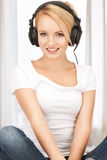Happy teenage girl in big headphones Stock Photos