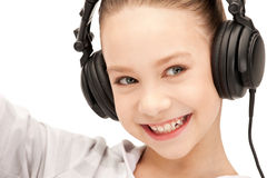 Happy teenage girl in big headphones Royalty Free Stock Photography