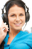 Happy teenage girl in big headphones Royalty Free Stock Photos