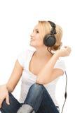 happy teenage girl in big headphones Stock Image