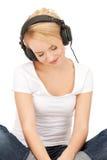 happy teenage girl in big headphones Stock Photos
