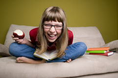 Happy teenage girl with book Royalty Free Stock Images