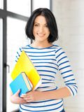 Happy teenage girl with books and folders Royalty Free Stock Photography