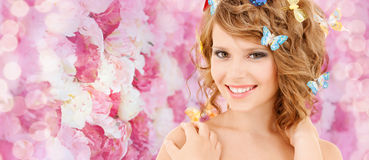 Happy teenage girl with butterflies in hair Royalty Free Stock Photography